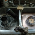 Place the basket in a sink of warm water while you finish cleaning up and it will be a cinch to clean.